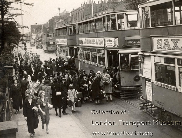 Children from the Charles Edward Brooke (girls) School boarding trams in Camberwell New Road. The children are to be taken to Waterloo station for evacuation, 1939. (1998/36461)