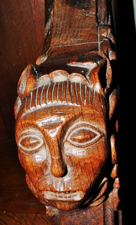 Head Carving on Chancel Pew.JPG